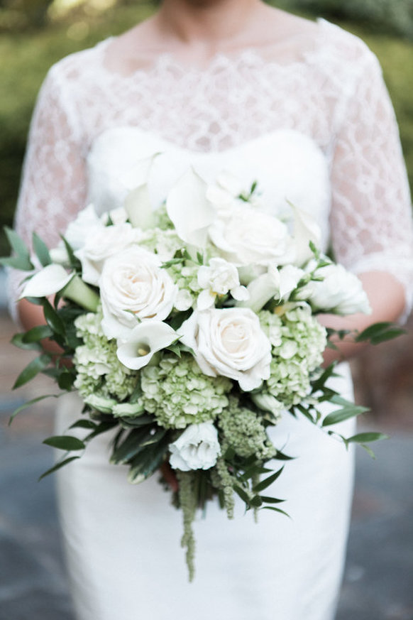 cream and white bridal bouquet with roses and hydrangeas
