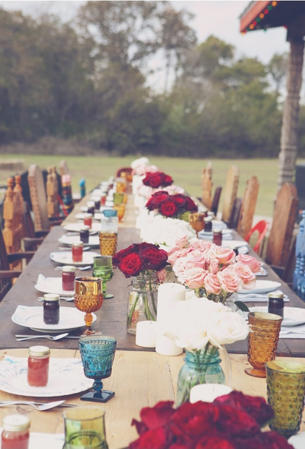Colorful mismatched goblets wedding place setting