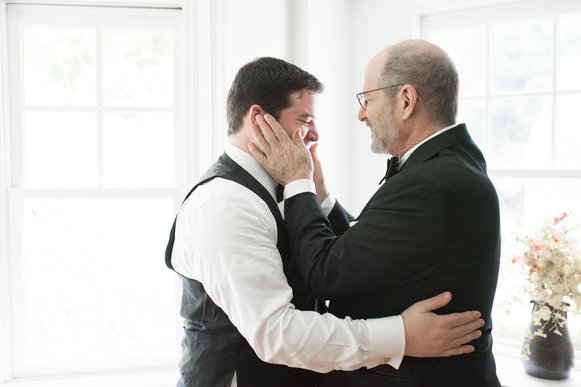 father and son on wedding day